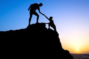 woman achieving climbing goals