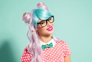 woman with pink hair expressing herself